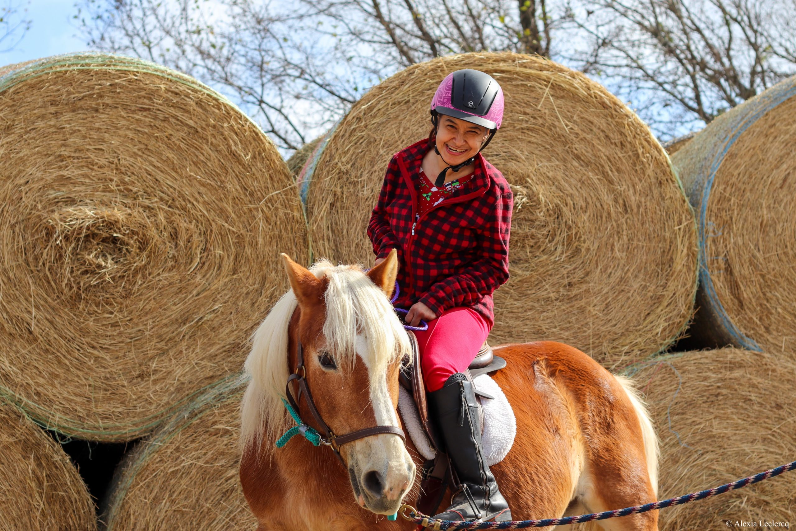 Student and horse, Story, in front of the hay bales.